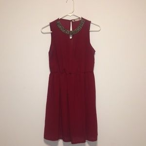 Dresses & Skirts - Red mini dress with beaded detailing